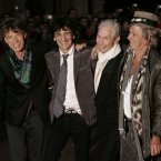 From left, Mick Jagger, Ronnie Wood, Charlie Watts and Keith Richards, posing for photographers as they arrive for the UK premiere of the film 'Shine A Light' at the Odeon Leicester Square, London, Wednesday April 2, 2008. (AP Photo/Nathan Strange)