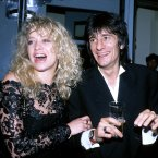Rolling Stones guitarist Ronnie Wood with his wife Jo in 1991. 