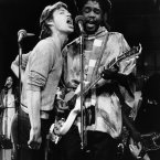 Mick Jagger, left, of the Rolling Stones, joins Peter Tosh in duet during rehearsal for NBC-TV's Saturday Night Live program, Friday, Dec. 16, 1978 in New York. The two were rehearsing for the live program, which is to be broadcast from New York City on Saturday night. (AP Photo)