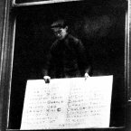 The first roll of survivors of the sinking of the Lusitania being posted in Liverpool.