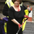Health Minister Mary Harney TD after she was pelted with red paint in protest at health cuts.