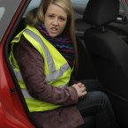 Dublin City Councillor Louise Minihan, sits in a Garda car after her initial arrest back in November 2010.