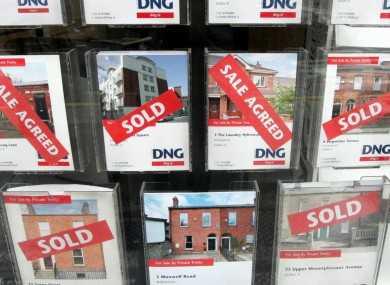 Sale Agreed signs in the window of a Dublin estate agent