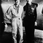 In a 1937 file photo aviator Amelia Earhart and her navigator, Fred Noonan, pose in front of their twin-engine Lockheed Electra in Los Angeles prior to their historic flight in which Earhart was attempting to become first female pilot to circle the globe. 