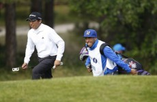 Carlos Tevez caddies for Andres Romero at the Open