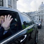 Dissolution of the 30th Dail. An Taoiseach Brian Cowen waves goodbye to the media as he leaves Government Buildings on his way to formally hand in his resignation to the President.