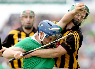 Limerick's Richie McCarthy battling with Kilkenny's Henry Shefflin.