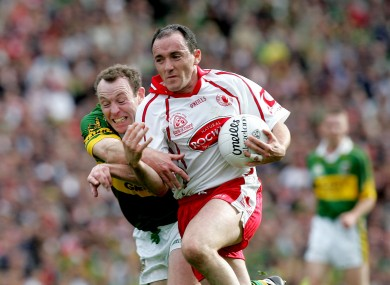 Brian Dooher accelerates past Seamus Moynihan in the 2005 final.