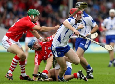 Cork's Eoin Cadogan and Waterford's John Mullane clashing in the 2010 Munster senior hurling final replay.