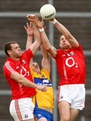 Cork and Clare players battle for possession during last year's championship tie.