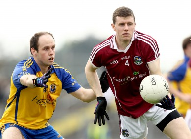 Keith Kelly (right) moves to corner back for Galway.