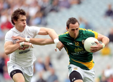 Meath's Graham Reilly and Emmet Bolton of Kildare in action.