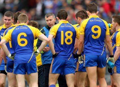 Roscommon manager Des Newton speaks to his team on the field at half-time of their tie with Armagh.