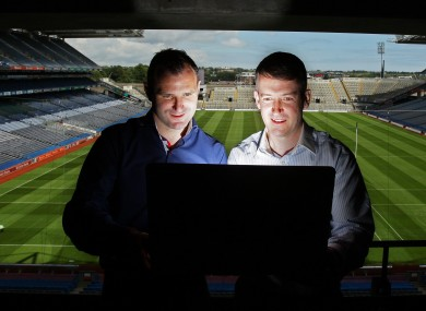 Armagh legend Steven McDonnell and Cork hurling goalkeeper Donal Og Cusack tune in at Croke Park yesterday.