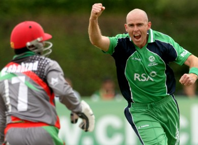 Trent Johnston celebrates the wicket of Mohammad Shahzad.