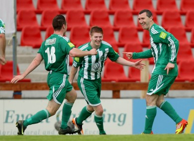Jason Byrne (right) celebrates his goal with team-mates.