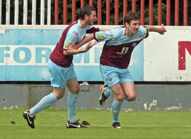 Gavin Brennan celebrates his goal with brother Ryan. 