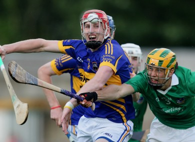 Limerick's Dan Morrissey and Denis Maher of Tipperary battle for possession.