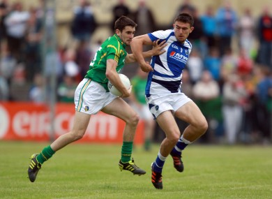 Colm Clarke of Leitrim with Colm Begley of Laois.