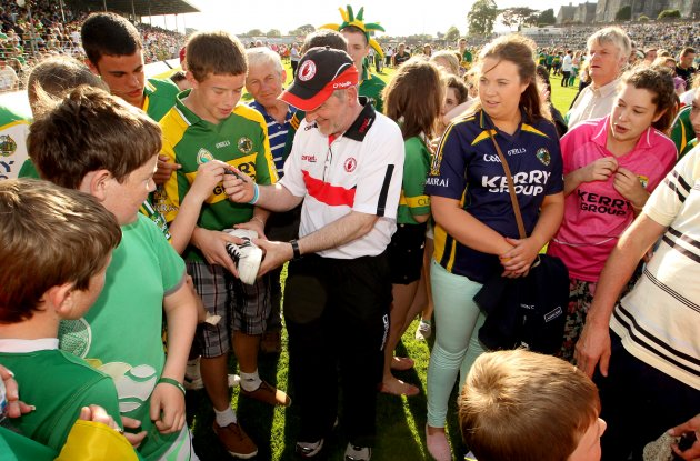 Mickey Harte signs autographs for fans after the game 21/7/2012