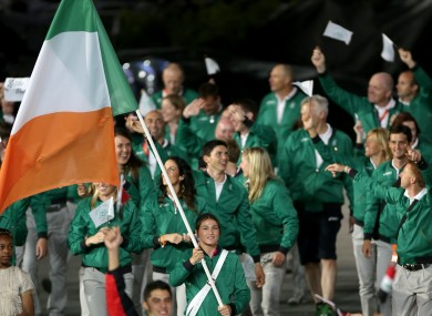 Katie Taylor leads the Irish team in the arena.
