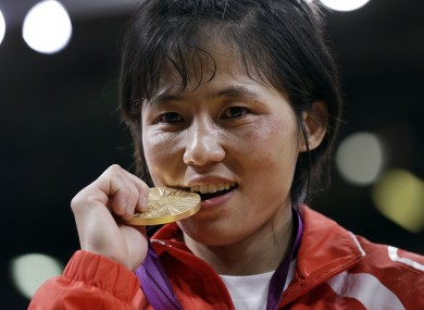 North Korea's An Kum Ae celebrates taking gold in her judo category.