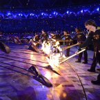 The Olympic cauldron is lit by seven young athletes as the finale of Friday's opening ceremony for London 2012. (AP Photo/Leon Neal)