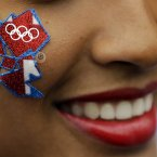A young woman wears a London Olympics logo on her cheek. (AP Photo/Matt Rourke)
