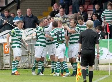 Ronan Finn of Shamrock Rovers is mobbed after scoring.