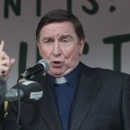 Fr Brian D'Arcy speaks as thousands of People Attends a rally in support of Formerly Ireland's richest man, Sean Quinn and his Family in Ballyconnell in Co Cavan tonight   Picture date:Sunday July 29, 2012. Photo credit should read: Niall carson/PA Wire