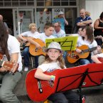 Lauren Galvin (left, 10) and Vicki Millar Murphy (centre, 8) from Co Cavan busk for charity during Fleadh Cheoil na h'Eireann. (Photo: Laura Hutton/Photocall Ireland)