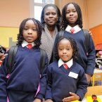 Sarah Wuddah pictured with her three daughters, Ajoa (7), Aba (4) and Essie (9) on Aba's first day of big school. Photo: Laura Hutton/Photocall Ireland