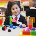 It's all no bother to An Nguyen as she enjoys playing with blocks on her first day. Photo: Laura Hutton/Photocall Ireland