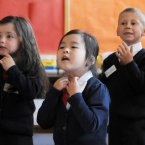 The class of new Junior Infants at Gardiner Street School in Dublin sing 'Head, Shoulders, Knees and Toes' on their first day of lessons.  Photo: Laura Hutton/Photocall Ireland