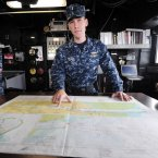 Lt JG Christopher Mikell of the US Navy points to a map of Dublin Port which the USS Fort McHenry used to docked at Dublin Port last night. (Photo: Laura Hutton/Photocall Ireland)