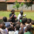 Children getting sweets after receiving their ringworm medication