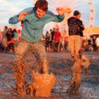 Fans enjoy the mud and the music at the Oxegen 2007 Music Festival in Punchestown Racecourse in County Kildare. Pic: Albert Gonzalez / Photocall Ireland