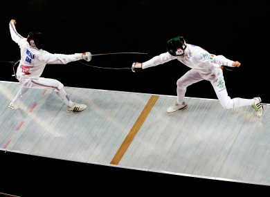 Ireland's Arthur Lanigan O'Keeffe, right, on the piste during the modern pentathlon.