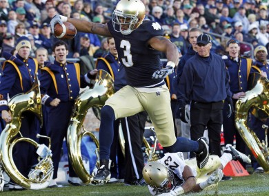 Notre Dame wide receiver Michael Floyd (3) scores a touchdown after getting past Navy cornerback Eric Graham in 2011.
