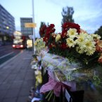Flowers and tributes were left for Mark Duggan, a 29-year-old father of four, who was gunned down by police in disputed circumstances a week before the riots began. (AP Photo/Lefteris Pitarakis)