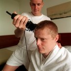 Getting a trim from team-mate Barry Quinn