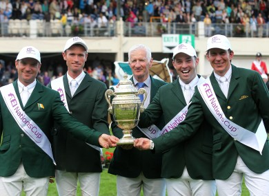 Chef d'Equipe Robert Splaine with the Aga Khan trophy and riders from left, Darragh Kerins, Richie Moloney, Cian O'Connor and Clem McMahon.