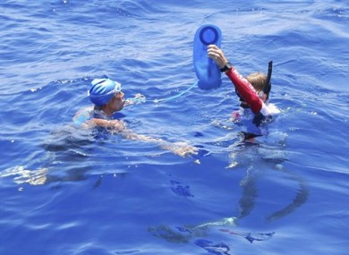  Diana Nyad is hydrated by a crew member in the Florida Straits yesterday.