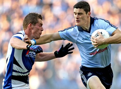 Arm's length: Diarmuid Connolly holds off Darren Strong as his side just held off Laois