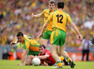 Cork's Donncha O'Connor under pressure from Leo McLoone, David Walsh and Mark McHugh of Donegal.
