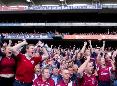 Galway fans celebrate late in the game yesterday.