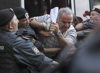 Police officers detain former world chess champion Garry Kasparov, a leading opposition activist, outside the court where a trial of the feminist punk group Pussy Riot is held, in Moscow on Friday,
