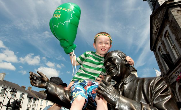 John Joe's cousin Davy Nevin celebrates beside the Joe Dolan statue 10/8/2012