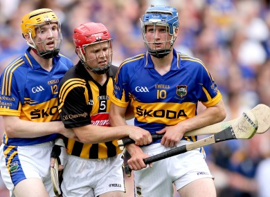 Tipperary's Lar Corbett and Pa Bourke with Kilkenny's Tommy Walsh. 