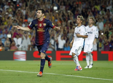 Lionel Messi celebrates after putting Barcelona 2-1 up from the penalty spot.